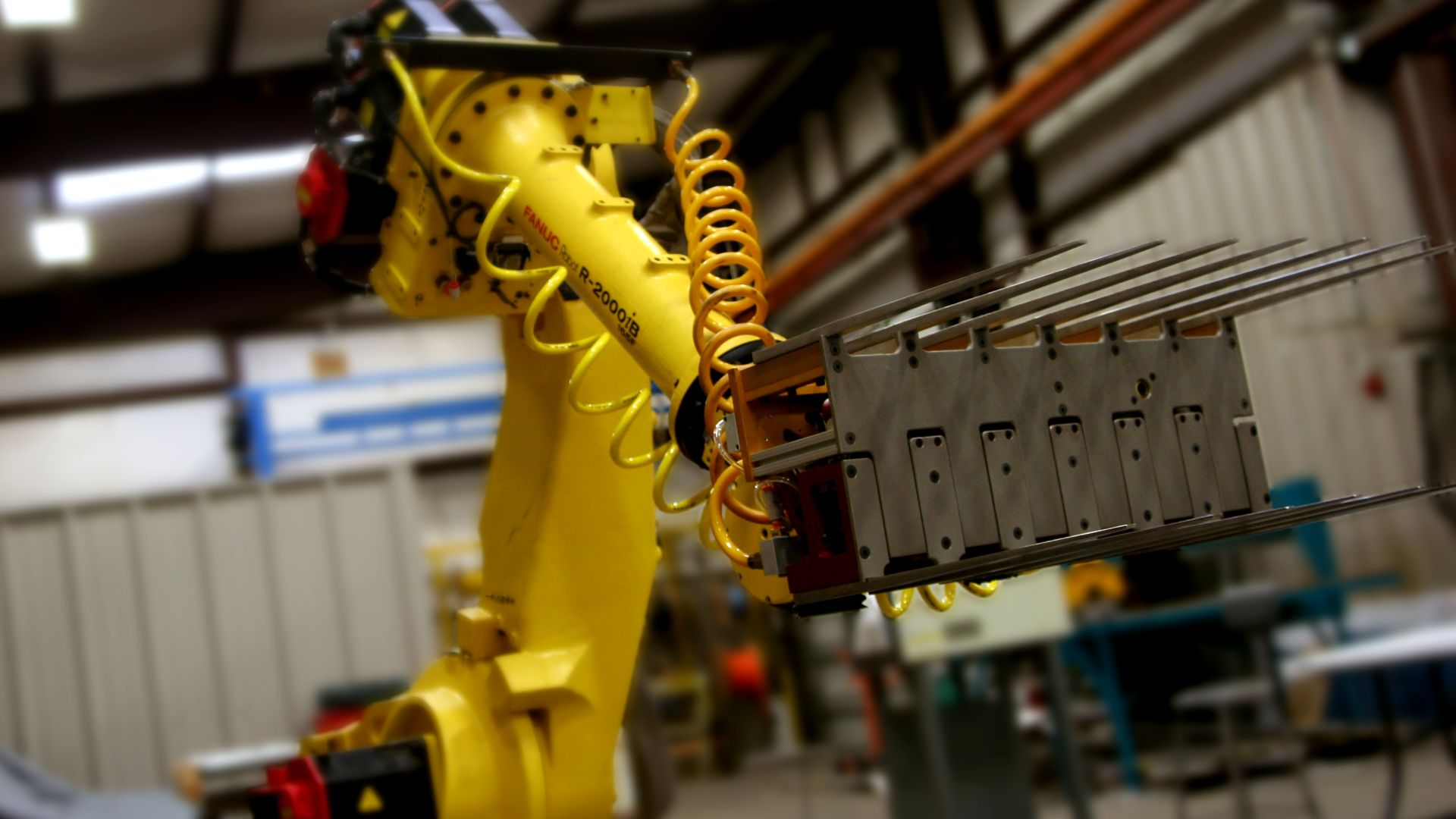 This warehouse automation system's primary function is palletizing cartons.  This Fanuc Arm Robot utilizes an EOAT (End of Arm Tool), ...